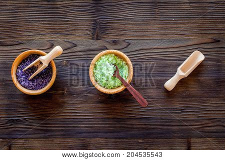 organic cosmetic set with lavender herbs and sea salt in bowl on wooden table background flat lay mockup