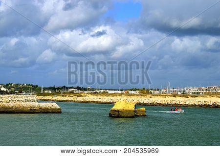 Lagos Algarve Portugal - October 28 2015 : Motorboat on the Bensafrim river in Lagos harbour