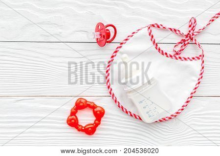preparation of mixture baby feeding with infant formula powdered milk on white wooden background top view mock-up