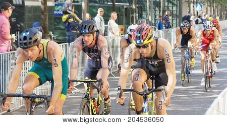 STOCKHOLM - AUG 26 2017: Jonathan Brownlee and group of male triathlete cyclists in the Men's ITU World Triathlon series event August 26 2017 in Stockholm Sweden
