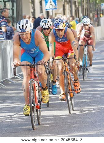 STOCKHOLM - AUG 26 2017: Closeup of fighting cycling triathletes Blummenfelt Mola and competitors in the Men's ITU World Triathlon series event August 26 2017 in Stockholm Sweden