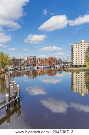 Apartment Buildings With Reflection In The Water In Groningen