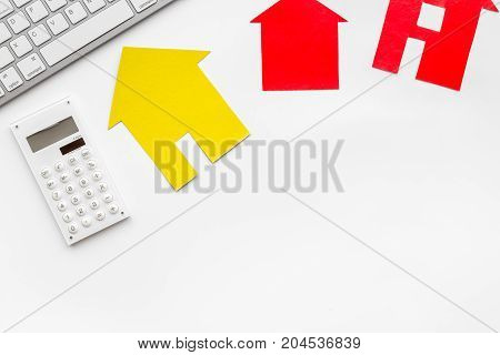 purchasing house set with paper figure on work desk white background top view mock up