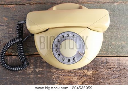 Beige Retro Telephone On Grey Wooden Table