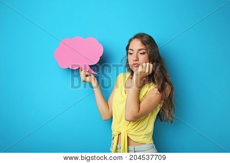 Young Woman With Speech Bubble On Blue Background