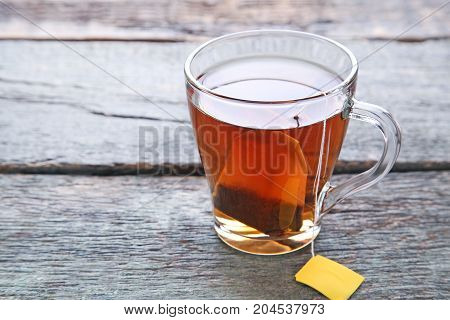 Cup Of Tea With Teabag On Wooden Table