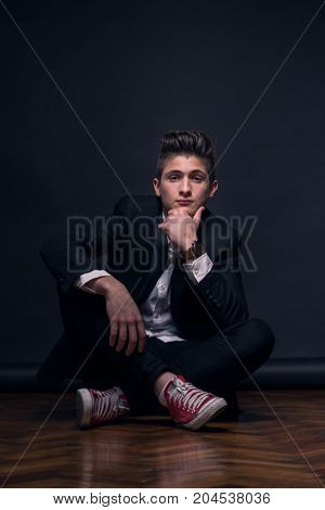 One Young Teenage Boy, Sitting, Legs Crossed,