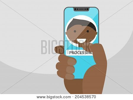 Face recognition concept to unlock a smartphone. Face icon displayed on frameless touchscreen. Hand holding bezel-less smartphone