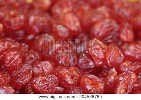 Heap of dried cranberries red dried fruits background
