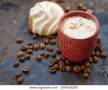 Cappuccino and chocolate marshmallows on a grunge background