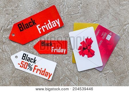 Words black friday on colored labels near cards on light background top view.