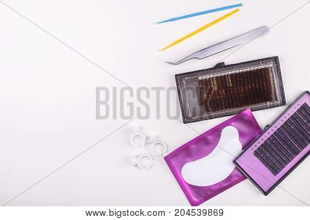Eyelash Extension tools on white background. Accessories for eyelash extensions. Artificial lashes. Top view
