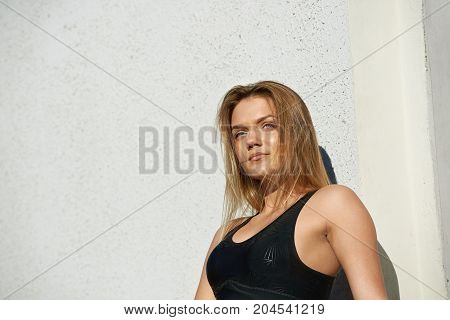 People sports fitness active healthy lifestyle and determination concept. Beautiful determined young blonde female runner wearing stylish black sports bra setting her mind up before marathon