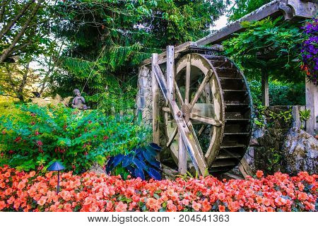#36 wheel fountain butchart gardens VICTORIA, BC - AUGUST 20, 2016 - A spinning wheel fountain in Butchart Gardens on August 20, 2016, in Victoria.