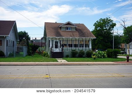 JOLIET, ILLINOIS / UNITED STATES - JULY 21, 2017: A small, single family home, on Plainfield Road in Joliet.