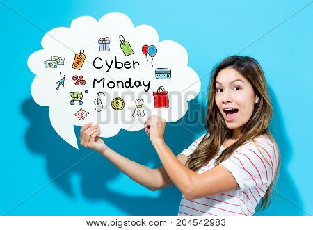 Cyber Monday text with young woman holding a speech bubble on a blue background