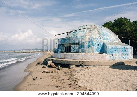 Old military bunker in Albania from Enver Hoxha's dictatorship on the Adriatic Sea in the resort area of Golem