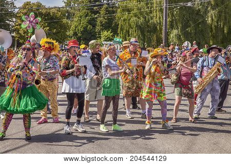 SEATTLE WA - JUNE 22 2013: An unidentified band in brightly colored costumes performs during the Honkfest portion of the annual Fremont Summer Solstice Festival in Seattle.