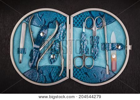 manicure set with stainless steel in leather case; scissors cuticle nippers nail file tweezers washer