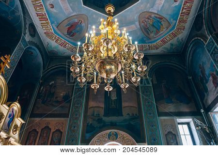 Dnipro Ukraine - August 06 2017: Church of St. Nicholas large gold or bronze chandelier in the temple or cathedral big bronze with handelier in the church orthodox church inside