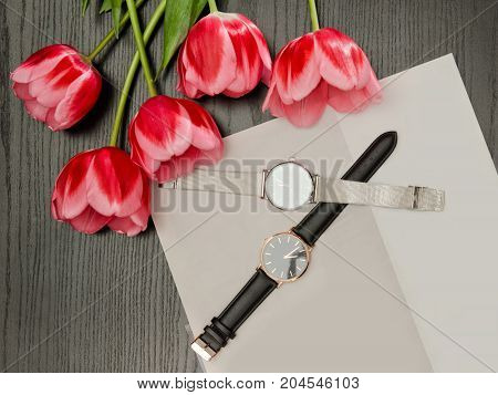 Two Wristwatches On A Gray Sheet And Tulips. Fashionable Concept, Top View