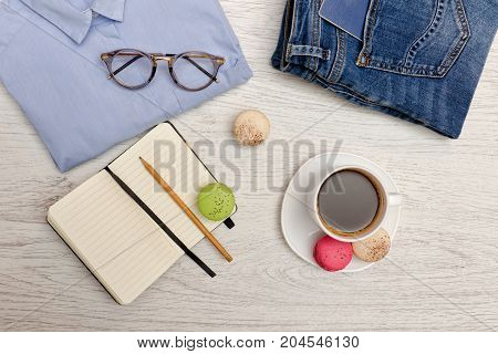 Planning Affairs. Blue Shirt, Jeans With A Passport, Notebook And Cup Of Coffee. Fashion Concept. To