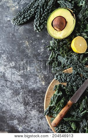 Fresh Leaves Of Kale Salad With Avocado, And Lemon. Italian Cuis