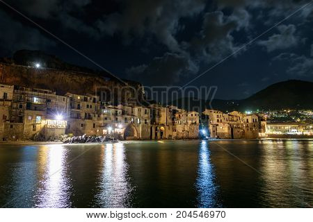 View of coast in Cefalu town on Sicily by night Italy
