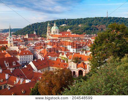 Lesser Town cityscape with St Nicholas Church, Prague, Czech Republic.