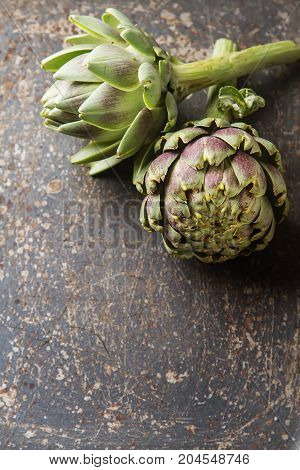 Baby Ripe Organic Artichokes On The Rustic Background. Top View