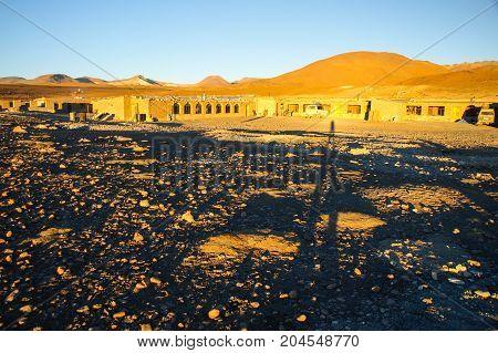 Evening landscape and accomodation buldings at Laguna Colorada, Altiplano area, Bolivia, South America.