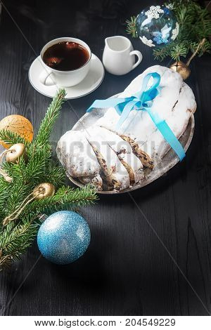 Christmas Stollen On A Silver Tray With A White Cup Of Hot Coffe