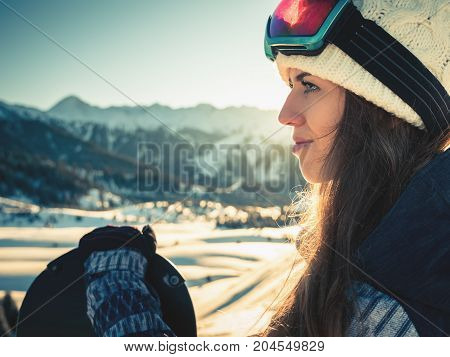 Portrait of snowboarder girl on the background of high mountain Alps in Switzerland. Adventure and hike healthy lifestyle