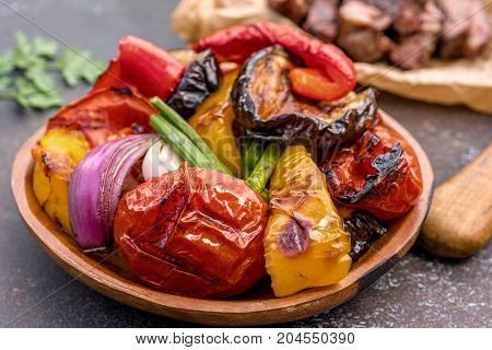 Grilled vegetables salad with eggplant, onions, peppers, asparagus, tomato and herbs
