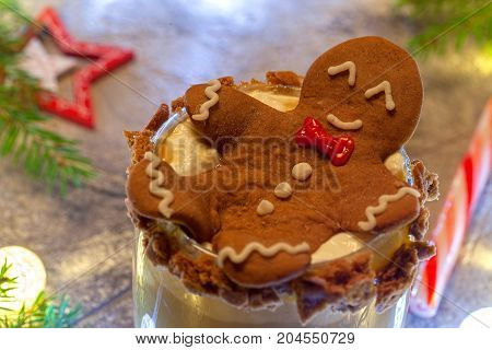 Drunken Gingerbread cookie man in a Christmas cocktail glass