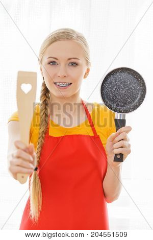 Woman Holding Cooking Pan And Spatula