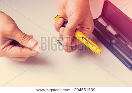 A man holds a syringe for subcutaneous injection of hormonal drugs in the IVF protocol (in vitro fertilization). Medical product in ampoules. Preparation for pregnancy. Helping Wife