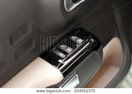 side mirror switch control, car interior detail