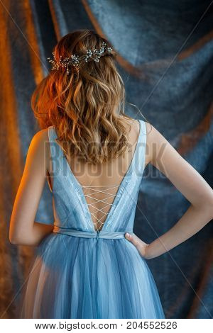 Morning bride's dresses in a gently blue dressing gown