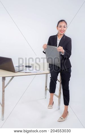 Businesswoman Hold File Document Looking Camera With Sitting Table In Office On White Background.