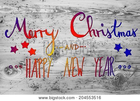 Colorful English Calligraphy Merry Christmas And Happy New Year. Gray Vintage Wooden Background