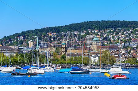 Zurich, Switzerland - 26 May, 2016: boats on Lake Zurich, buildings of the city of Zurich in the background. Lake Zurich is a lake in Switzerland, extending southeast of the city of Zurich, which is the largest city in Switzerland.