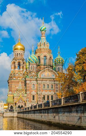 St Petersburg Russia. Cathedral of Our Savior on Spilled Blood and Griboedov channel in St Petersburg Russia.  Architecture autumn landscape of St Petersburg Orthodox landmark