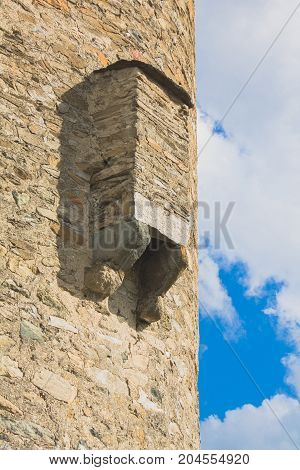 Stone tower with ledge roof see from bottom