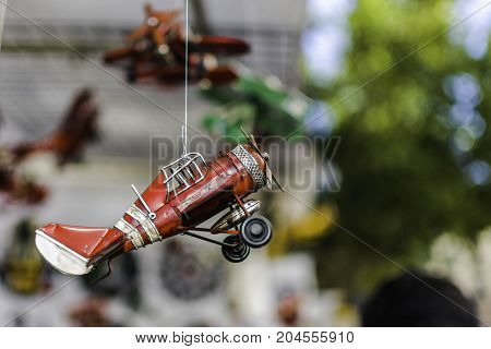 Scale model of old airplane hanging from a rope in a stall in El Rastro de Madrid