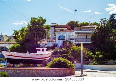 View Of The Promenade In The Seaside Town, In The Middle Of The Roundabout Old Fishing Boat