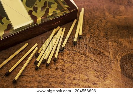 Boxes and matches on a dark brown wooden background