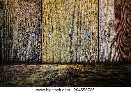 Brutal contrasting wooden brown background with nails