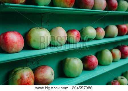 Fresh apples healthy, fruit stall in market shelf, perspective, selective focus