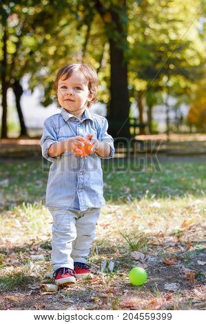 Adorable One Year Old Child In The Park
